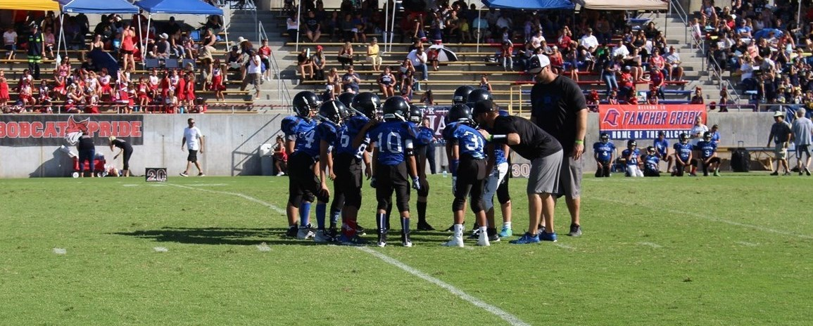 Charger Huddle at the Football Carnival